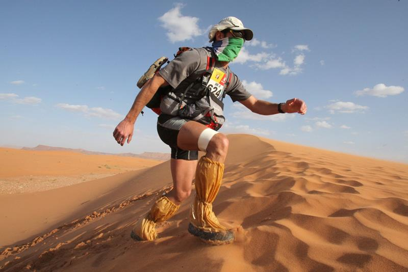 A competitor climbs a dune, during the third stage of the 24rd Marathon des Sables in the Sahara desert, some 300 kilometers, south of Ouarzazate, on April 1, 2009. The Desert Marathon is considered as the hardest in the world. Participants have to walk along more than 200 km during 7 days in the Sahara, Southern Morocco. 812 competitors are due to take part in the race. AFP PHOTO PIERRE VERDY (Photo credit should read PIERRE VERDY/ AFP/ Getty Images)
